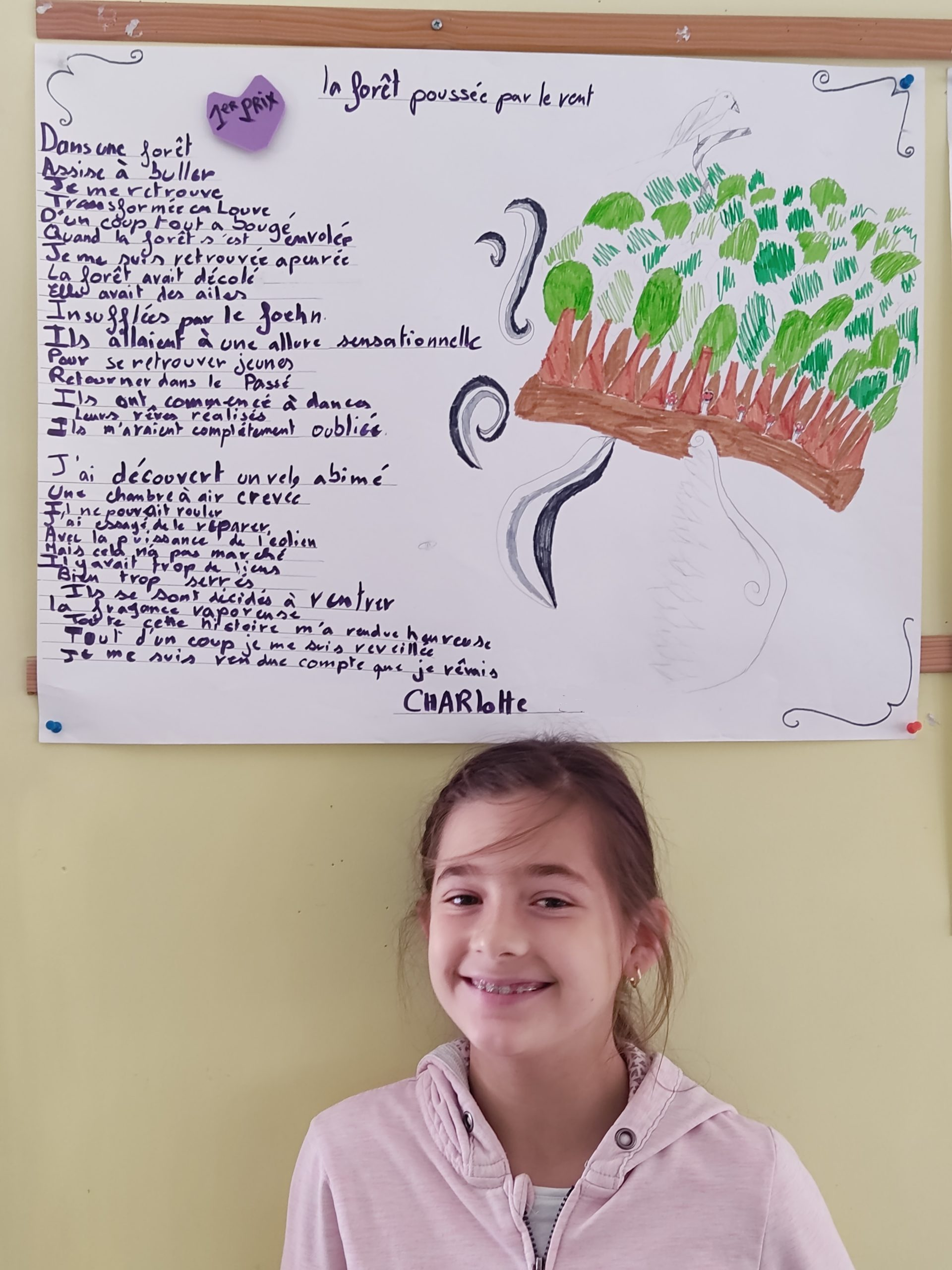 ecole sainte marie fuveau francophonie poème premier prix 2 la jeune fille qui a reçu le premier prix prise en photo et son poèrme au dessus-d'elle